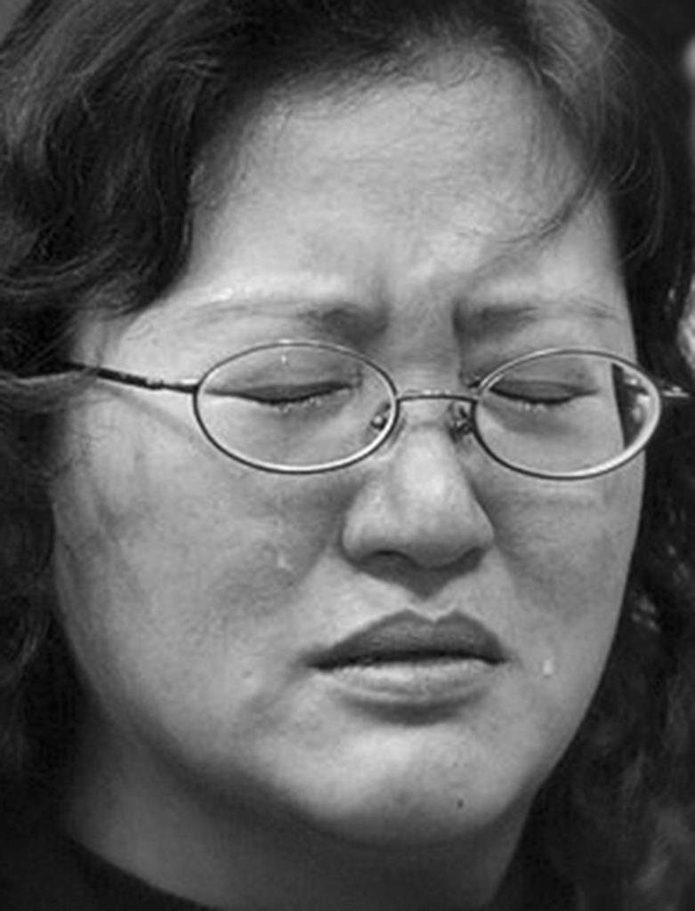 TAIPEI,TAIWAN-MARCH 19: A supporter of Taiwan President Chen Shui-bian shows her emotions outside Chen's election campaign headquarters in Taipei March 19, 2004. Taiwan President Chen Shui-bian survived an assassination attempt on Friday while campaigning on the eve of a presidential election he escaped and been released from the hospital with a bullet wound to the stomach. (photo by Paula Bronstein/Getty Images)